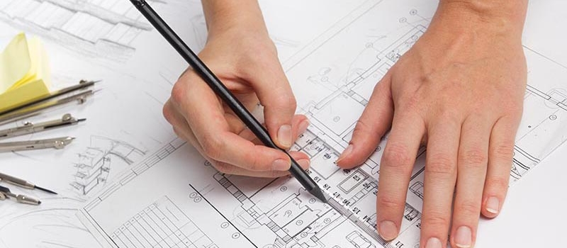 Architect working on blueprint. Architects workplace – architectural project, blueprints